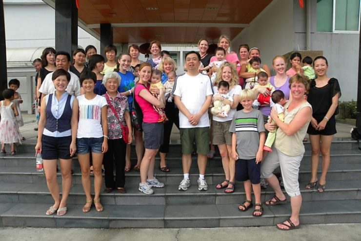 large group of Chinese families and Americans
