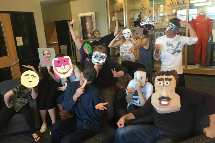 theatre students wearing various masks