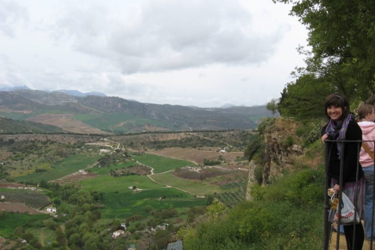 student overlooking fields and mountains in Spain