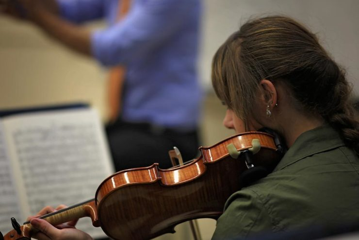 student playing the violin