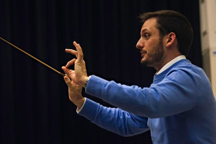 Prof. Nathan Miller directing the orchestra