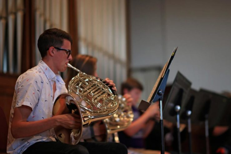 student playing a French horn