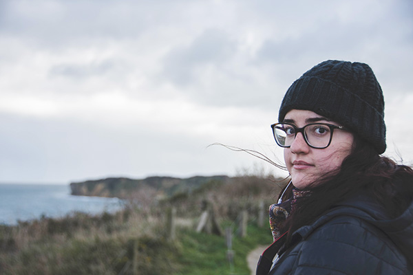 Student with glasses and knit cap