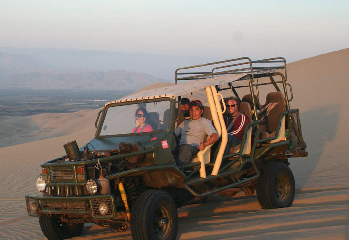 student in an open Jeep in Peru