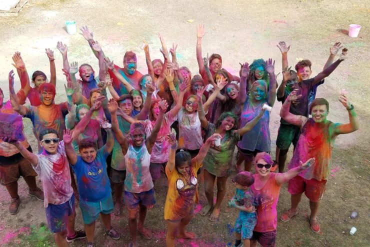 students and children at a color run in Spain
