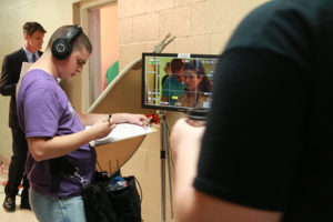 Student working on a film set