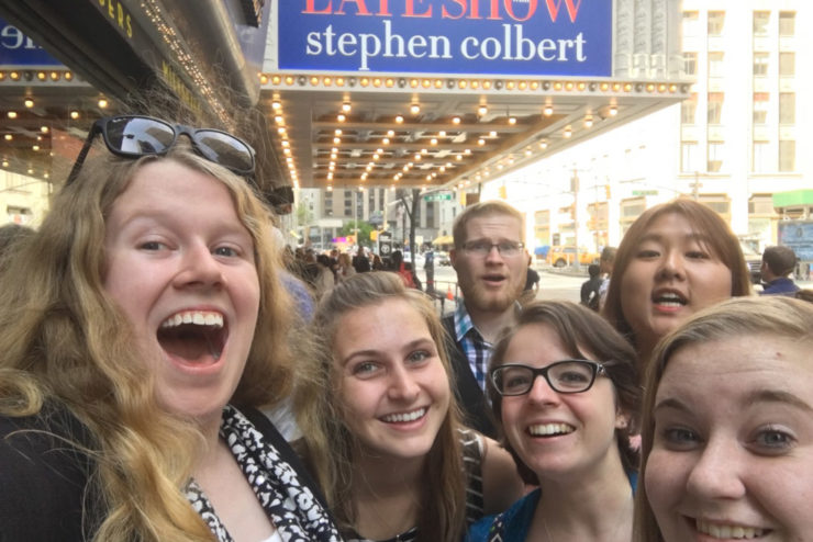 Students posing in front of the Late Show marquee