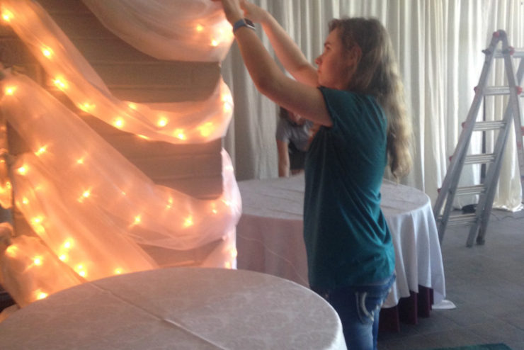 Student decorating a ballroom