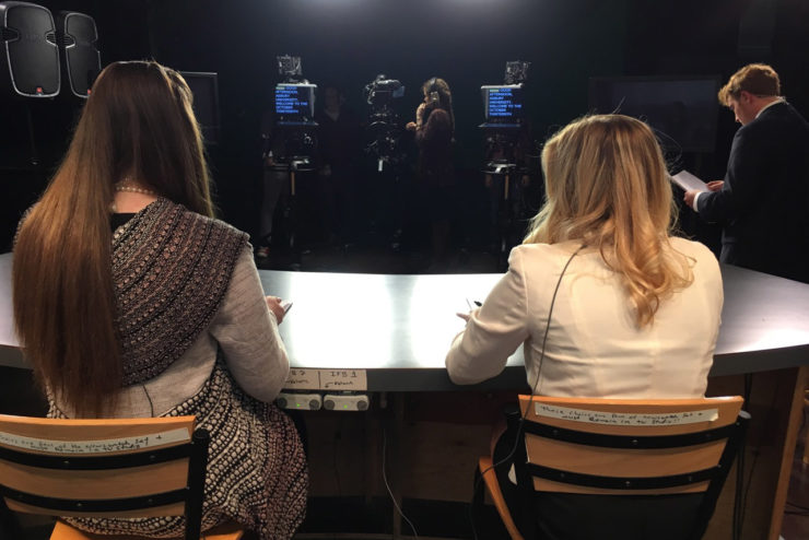 student presenters prepare for a news broadcast