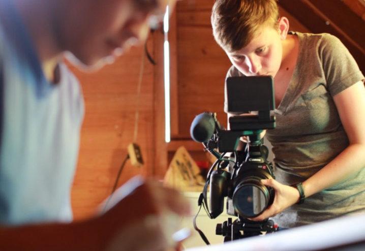Student filming an artist