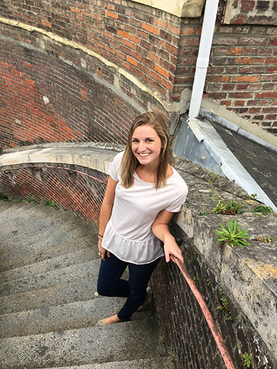Student posing on outdoor staircase
