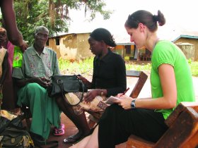 Student serving Africans in a village