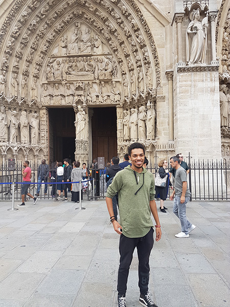 Student posing in front of a cathedral