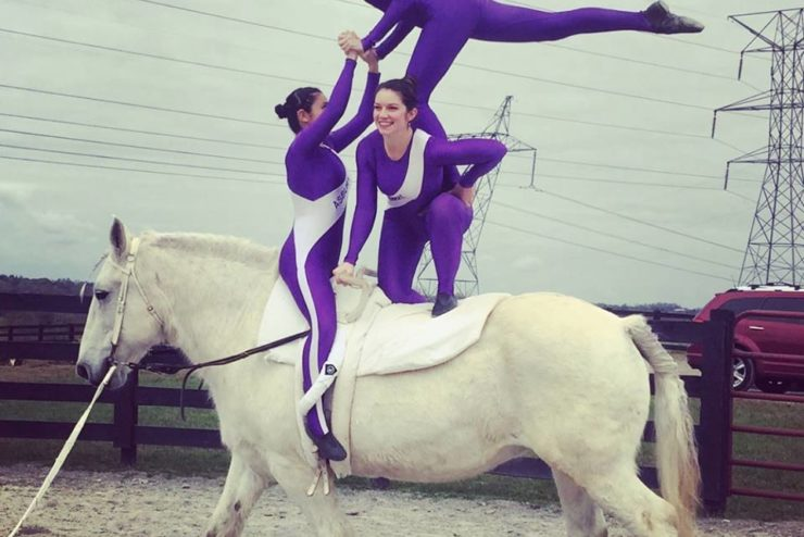 students performing vaulting