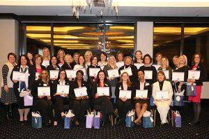 Educators posing with certificates
