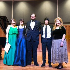 Student musician honors recipients standing together on stage