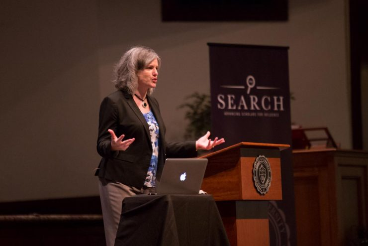 person speaking in Hughes Auditorium