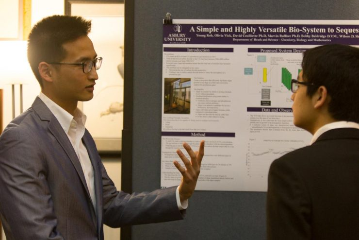 student giving a poster presentation