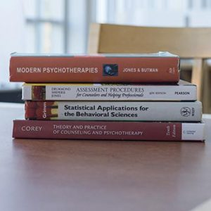 a stack of psychology textbooks
