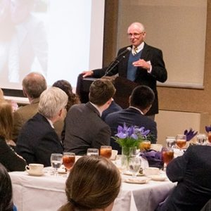 Howard Dayton speaking at a banquet