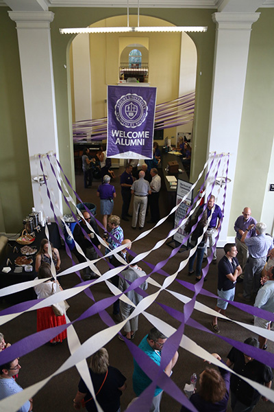 room decorated with purple and white banners and ribbons