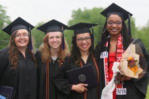 Graduates smiling for the camera