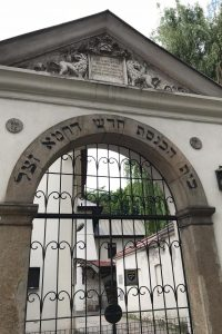 a concrete archway with Hebrew lettering