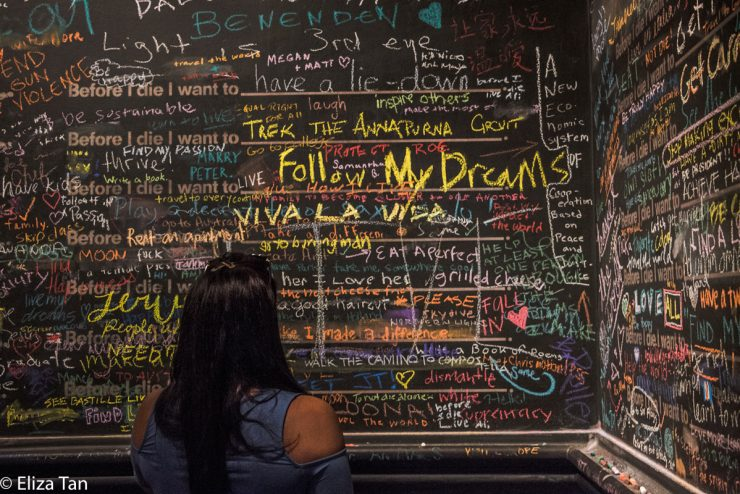 big chalkboard covered in writing