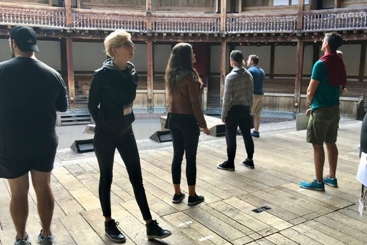 students standing on the stage of the Globe Theatre