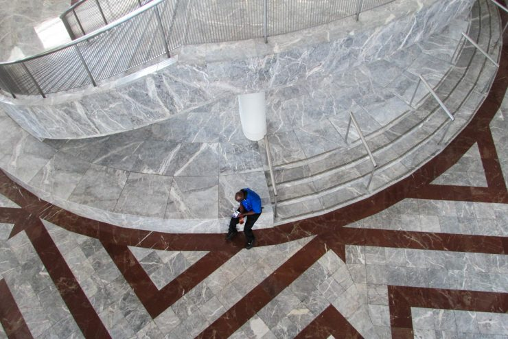 person sitting on marble steps