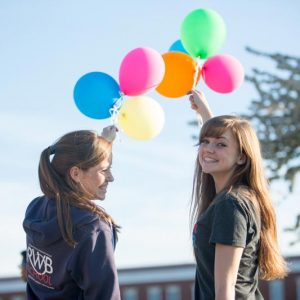 prospective students holding balloons