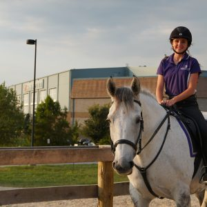 student riding a horse