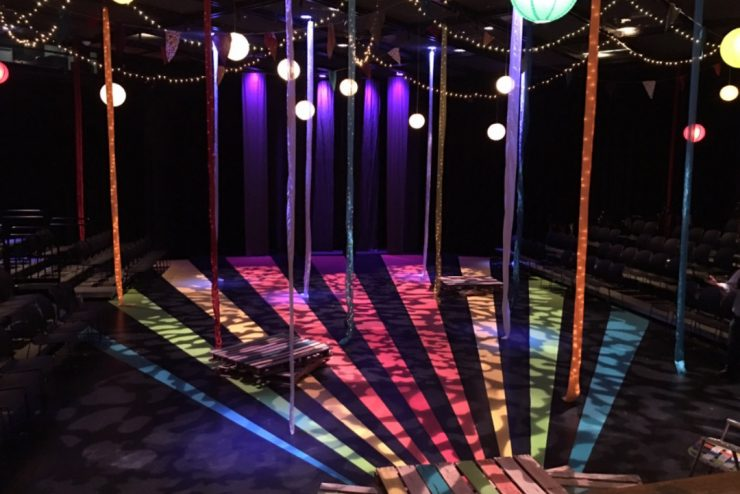 decorated theatre with colorful lights and hanging ribbons
