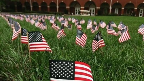 American flags on the green