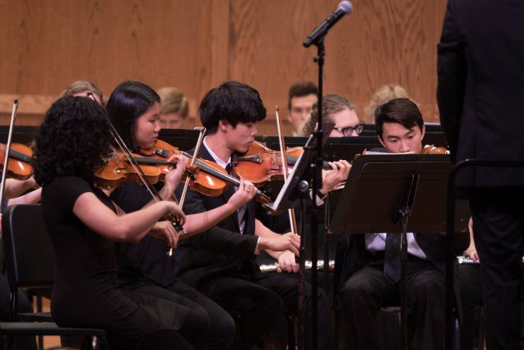 string section of student orchestra