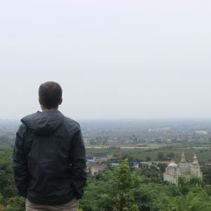 student standing at an overlook in China