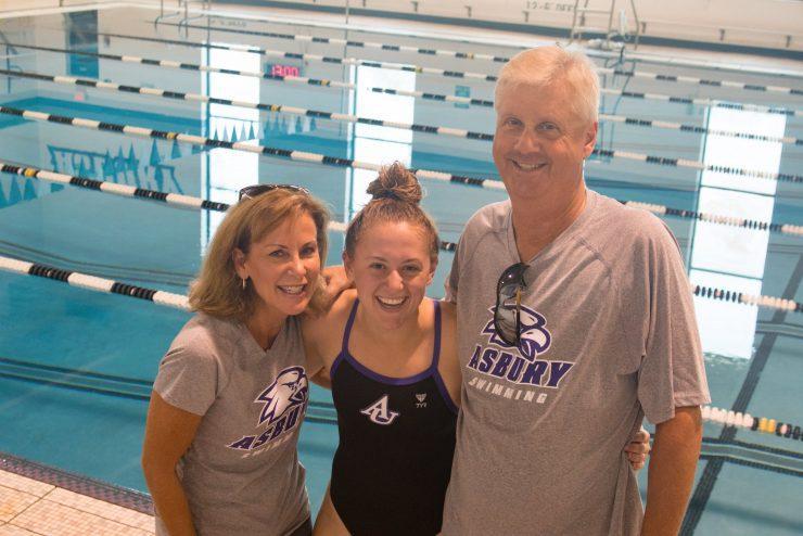 parents and swim team member