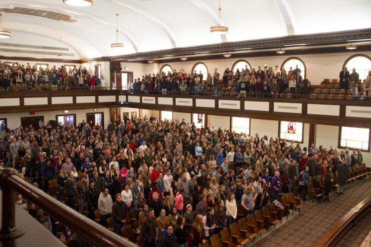 student body in chapel in Hughes Auditorium