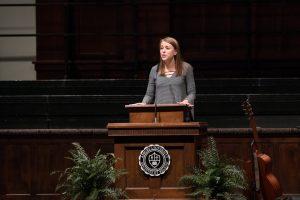 student speaking in chapel