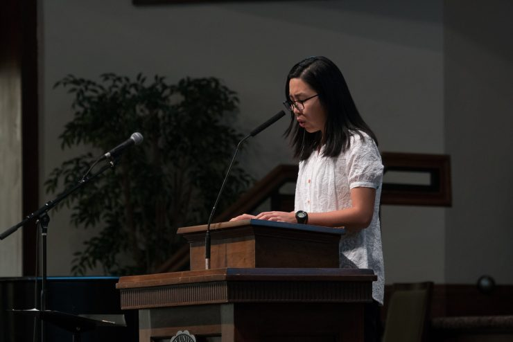 student speaking in chapel