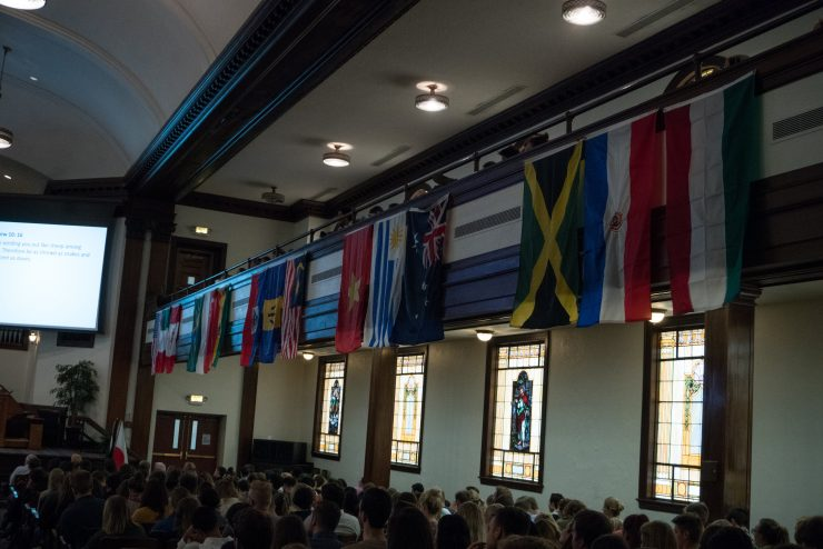 national flags in Hughes Auditorium