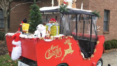 golf cart decorated to look like Santa's sleigh