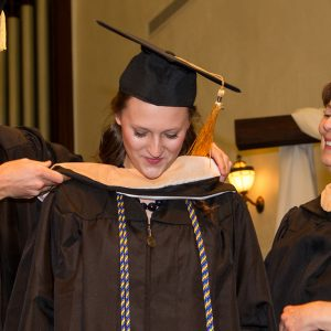 graduate student receiving hood