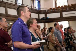 people singing in chapel