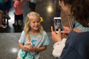 child holding ice cream