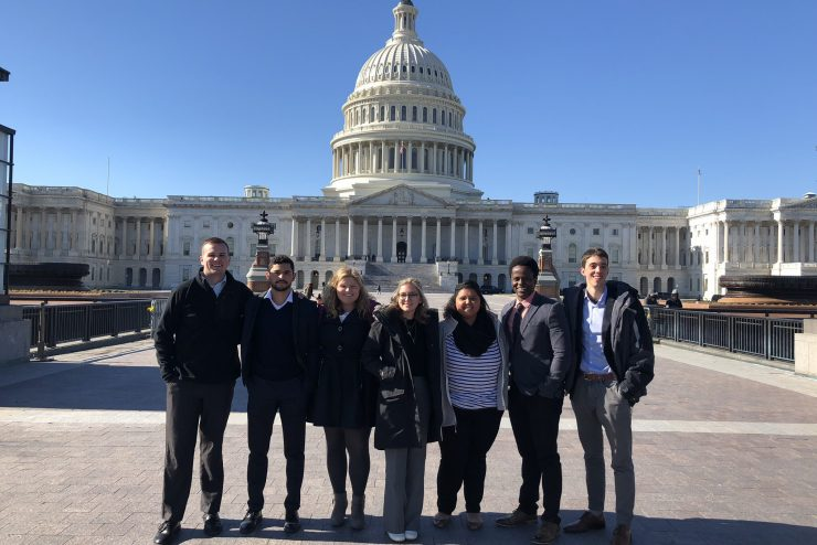 students standing in front of the U.S. capitol building
