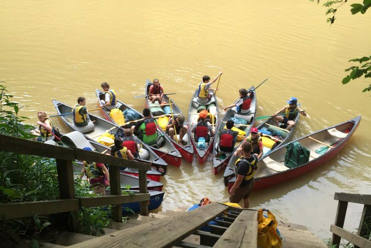 group of canoes all linked together