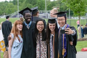 Asbury University graduates celebrating and taking a selfie