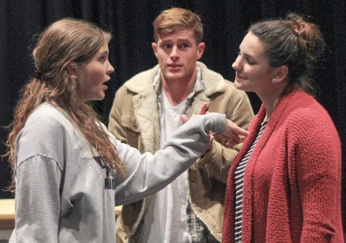 students acting in a play