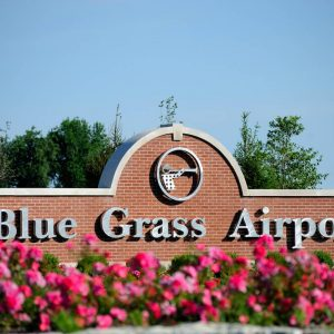 brick sign that says Blue Grass Airport